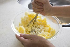 Schiacciare patate